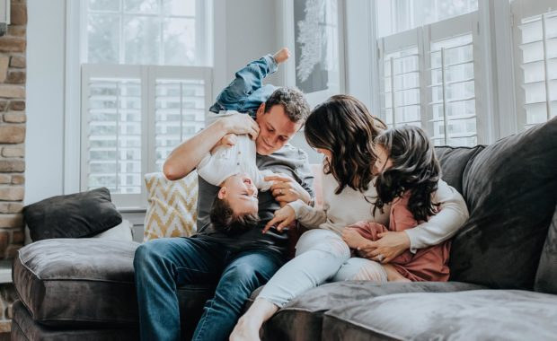 happy family at home sitting on couch